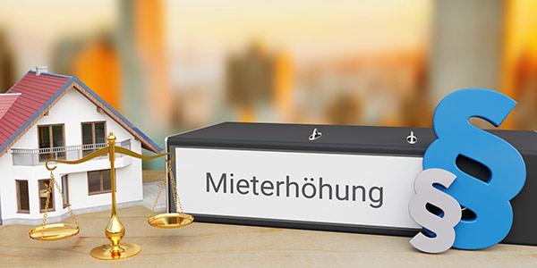 Ordner mit Aufschrift Mieterhöhung - Mietrecht Berlin